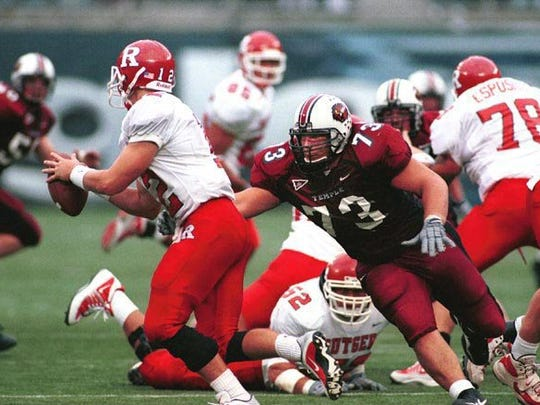 Temple's Dan Klecko zeroes in on the Rutgers quarterback in a 2002 game.