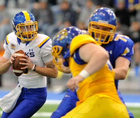 Dalton Douglas #8 looks for an open teammate during the SDSU spring football game at the Sanford Jackrabbit Athletic Complex in Brookings, S.D., Saturday, April 25, 2015.