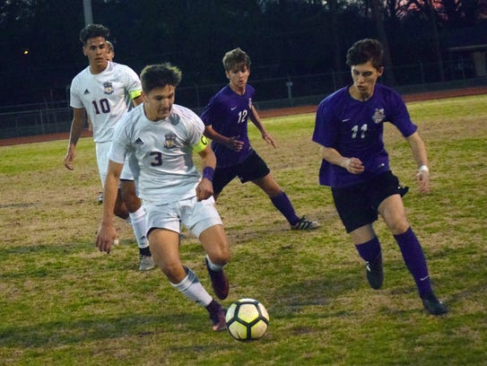 Alexandria Senior High's Robert Roy (3) kicks the ball