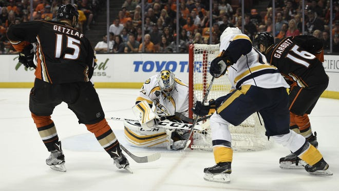 Ducks center Ryan Garbutt (16) scores a goal on Predators goalie Pekka Rinne (center) during the second period of Game 5 on Saturday.