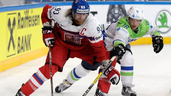 Slovenia's Ales Music, right, challenges for the puck Czech Republic's Jakub Voracek, left, during the Ice Hockey World Championships group B match between Czech Republic and Slovenia in the AccorHotels Arena in Paris, France, Friday, May 12, 2017. (AP Photo/Petr David Josek)