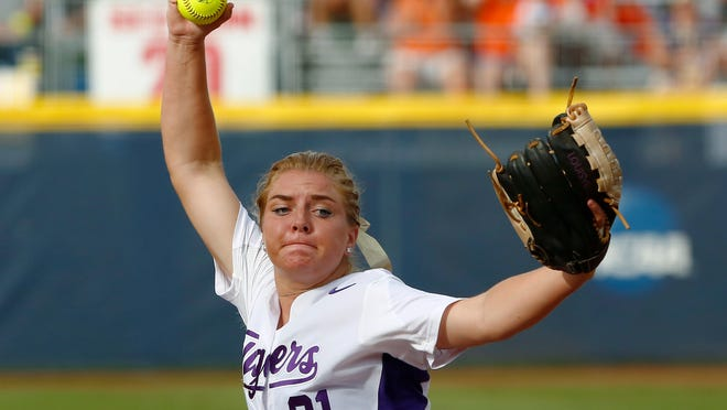 LSU's Carley Hoover pitches in the first inning against Florida in the NCAA Women's College World Series softball game in Oklahoma City, Friday, May 29, 2015. (AP Photo/Alonzo Adams)
