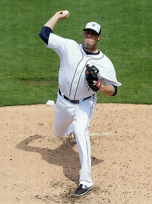 Joe Nathan pitches during the fourth inning against the Yankees on Friday.