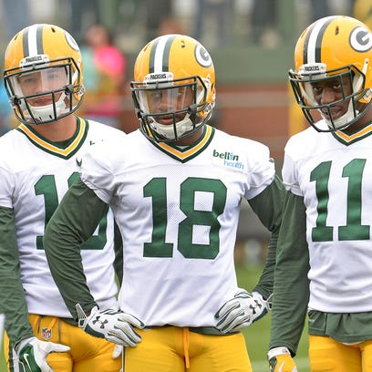 Packers receivers Myles White (19) Randall Cobb (18)