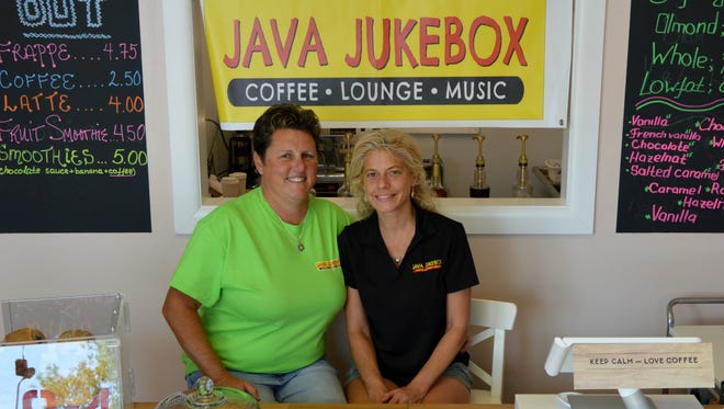 Nan and Kris Martino smile behind the counter at their new coffee shop, Java Jukebox, in Rehoboth Beach.