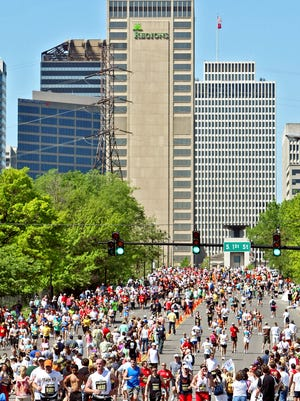 Runners cross the Woodland Bridge during the Country Music Marathon on April 25, 2009.