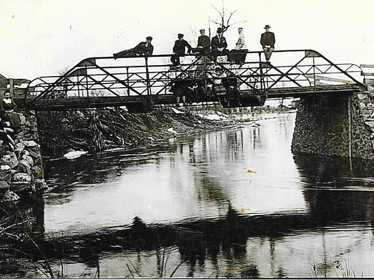 Students lounge over Mill Creek near the girls' dorm on the campus of Northwest Collegiate Institute in the town of Sherry.