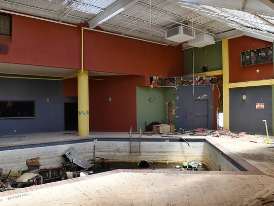 The indoor pool in a vacant hotel on Central Freeway,