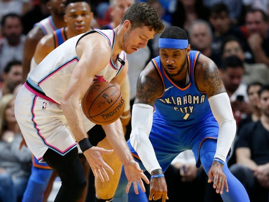 Miami Heat guard Goran Dragic, left, battles for the ball with Oklahoma City Thunder forward Carmelo Anthony during the first half of an NBA basketball game, Monday, April 9, 2018, in Miami. (AP Photo/Wilfredo Lee)