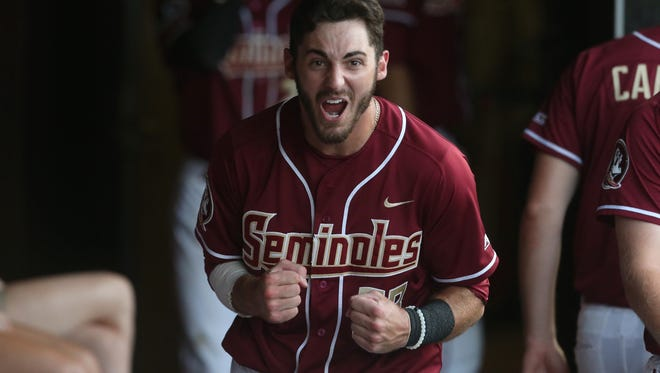 FSU's Dylan Busby celebrates in the dugout after hitting his second home run during their 7-3 win over Stetson at Dick Howser Stadium on Wednesday, April 19, 2017.