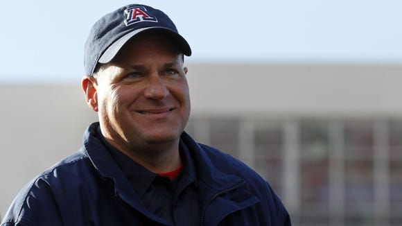 Dec. 31, 2013 - Arizona Wildcats head coach Rich Rodriguez smiles during the trophy presentations after defeating the Boston College Eagles 42-19 at Independence Stadium.