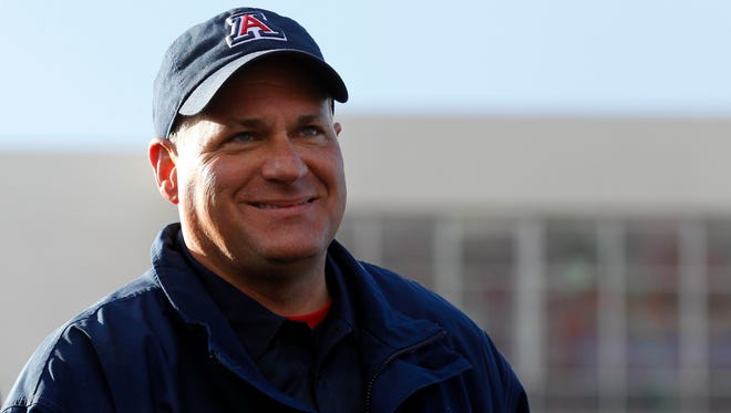 Arizona Wildcats head coach Rich Rodriguez smiles during the trophy presentations after defeating the Boston College Eagles 42-19 at Independence Stadium.