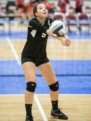 Pawlings' Emma Martin bumps the ball during a match