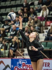 Walter Panas' Lauren Feeley serves the ball to King's