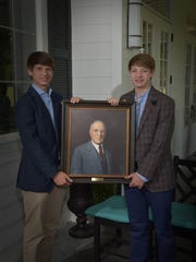 Stewart Briley and Andrew Briley unveiled a portrait