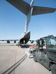 Airmen from the 123rd Airlift Wing load equipment onto a West Virginia Air National Guard C-17 at the Kentucky Air National Guard Base in Louisville, Ky., Sept 23, 2017, in support of Hurricane Maria recovery operations. Thirty-two members of the Kentucky ANG's 123rd Contingency Response Group, along with equipment, deployed to San Juan, Puerto Rico to establish an air cargo hub to process relief supplies.