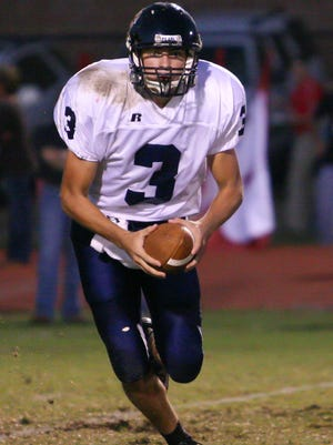 Former Pearl quarterback David Jeukens looks to make a play in a game during the 2007 season.