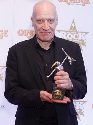 Wilko Johnson receives the Innovator Award at the Classic Rock Roll of Honor at The Roundhouse on November 14, 2013 in London, England.
