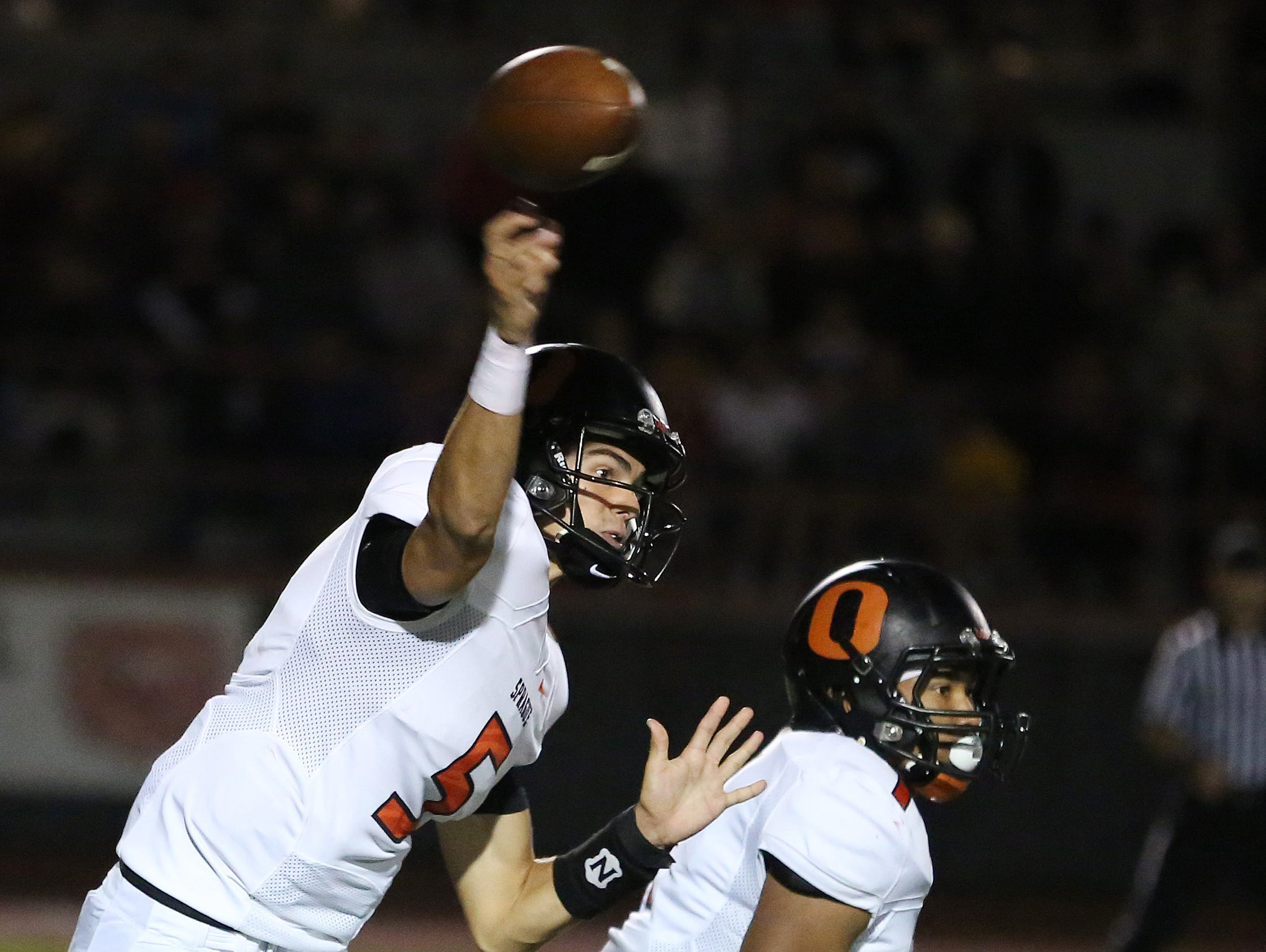 Sprague's Spencer Plant passes the ball as the Olys take on the McMinnville Grizzlies in Greater Valley Conference game on Friday, Sept. 23, 2016, in McMinnville.