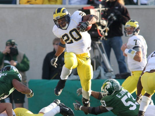 FILE – Mike Hart was a star for Michigan, playing under