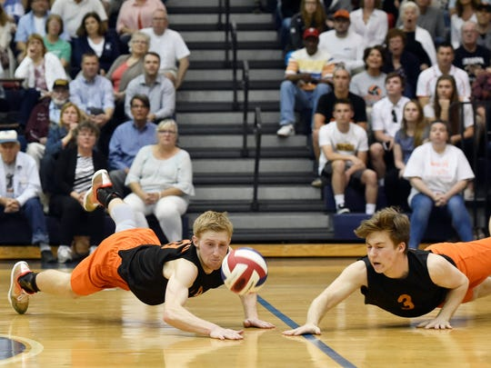 In this file photo,  York Suburban's Zach Weinstein and Noah Chojnacki dive for the ball in the District 3 Class 2A final last season. Chojnacki returns this season for the Trojans.