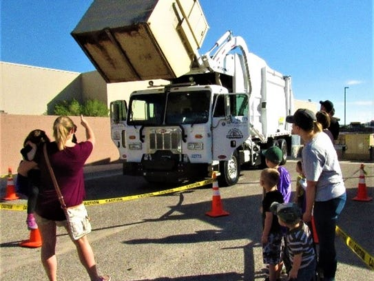Families gathered around to watch LCU trash trucks