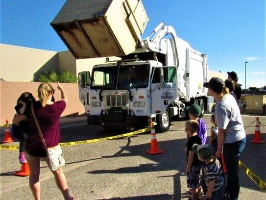 Families gathered around to watch LCU trash trucks
