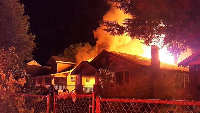 A residential block in the Park City section of Knoxville was shut down late Wednesday night as firefighters battled a blaze at a local home.