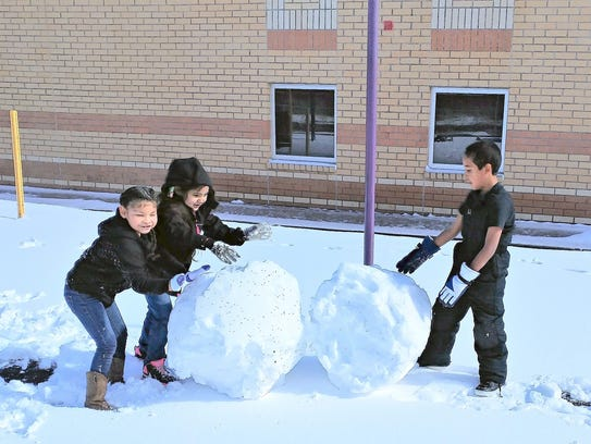 Three first-grade students at Mescalero School have