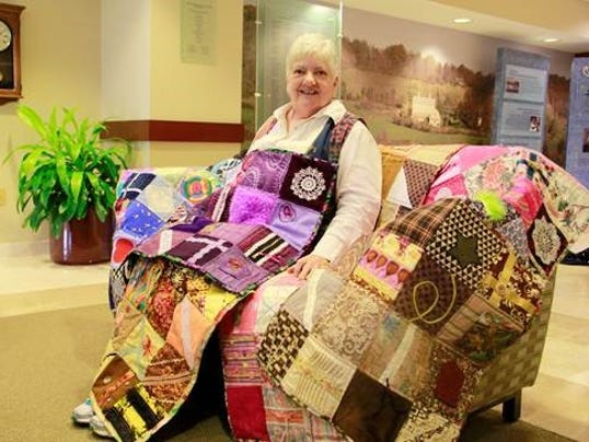 Janet-Wyckoff-and-her-figit-quilts.jpg