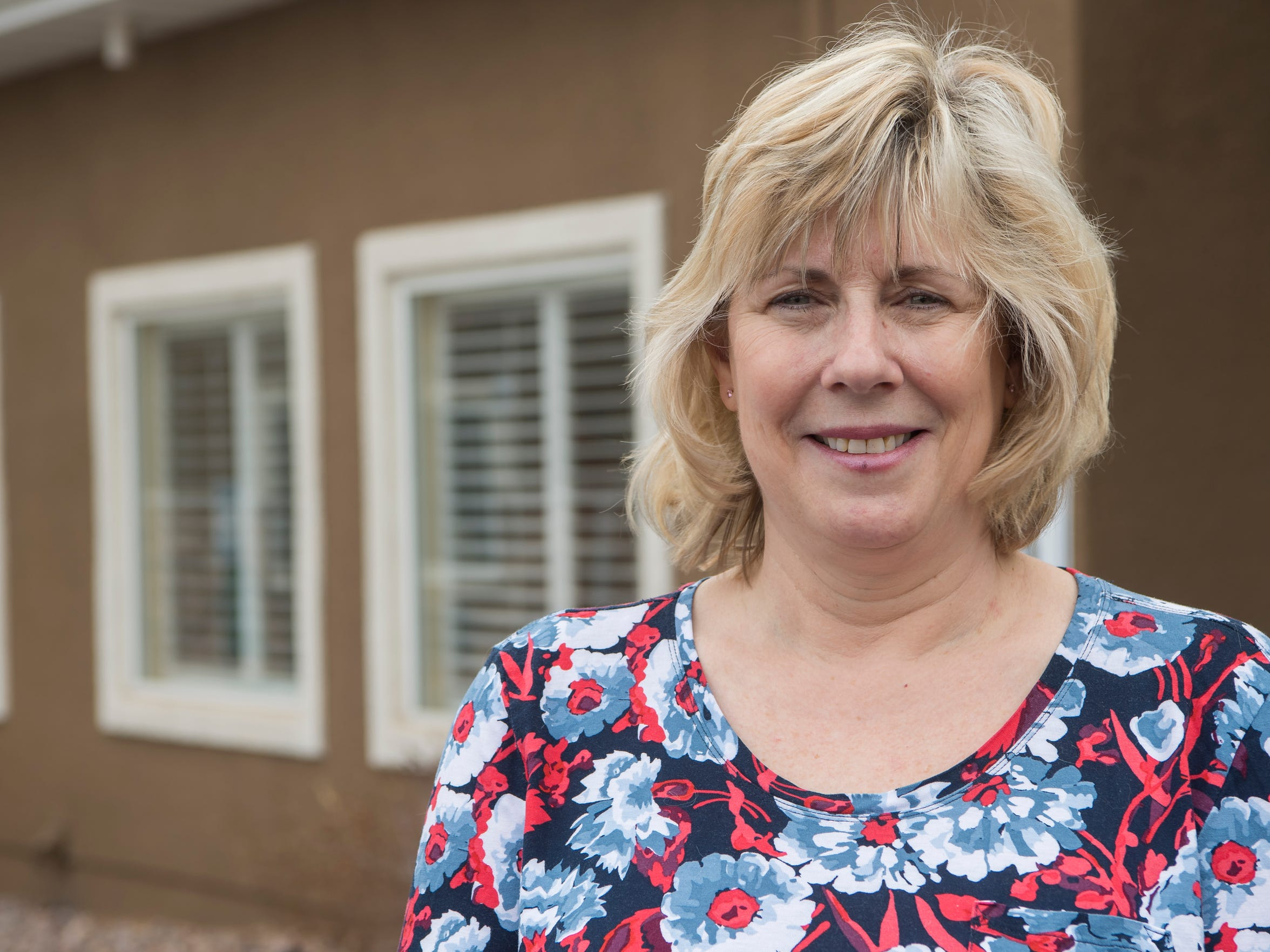Kathy Kirkland smiles outside the Southern Utah retirement home Brookdale, where she found her birth mother after 60 years.