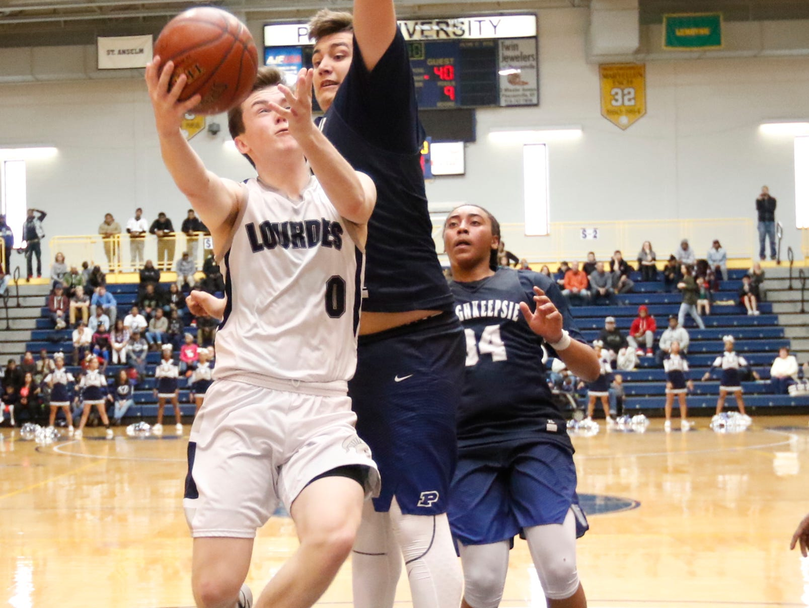 Our Lady of Lourdes High School's Brady Hildebrand take s a layup against Poughkeepsie on Saturday at Pace University.
