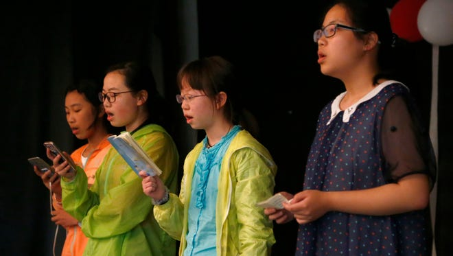 A group of students from Shanghai visited Mansfield Memorial Homes to sing select songs on Thursday. The students are visiting the United States for one week with host families to learn the English language and culture.