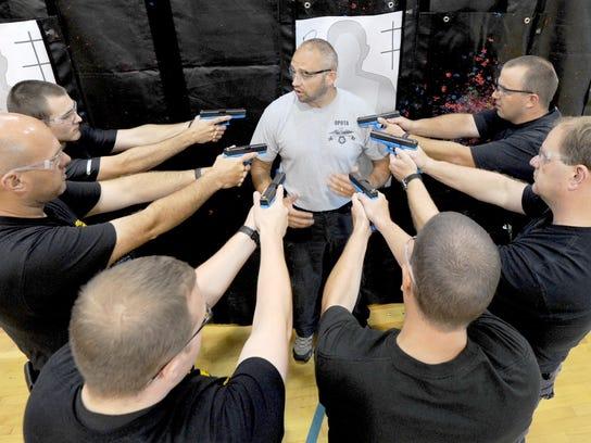 Instructor Travis McCourt talks to local law enforcement