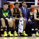 Oregon coach Dana Altman, right, speaks to players on the bench in the second half of an NCAA college basketball game against California Thursday, Feb. 11, 2016, in Berkeley, Calif. (AP Photo/Ben Margot)