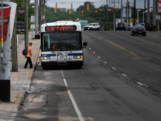 Commuters use the MTA bus system along Nolensville