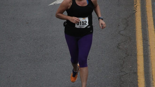 Jackie Quinlan, a Brookline resident, trained with Heartbreak Hill Running Company near Newton Centre for the Boston Marathon.