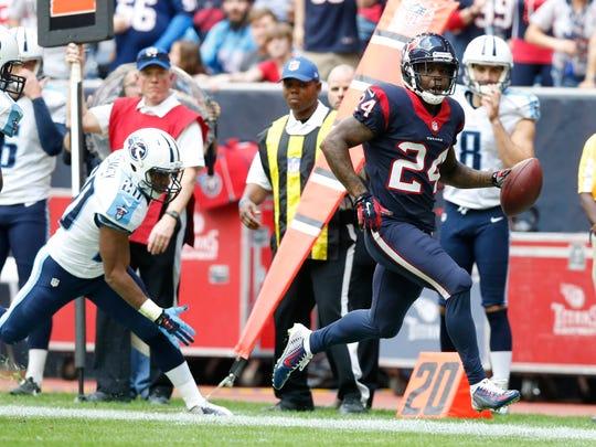 Houston Texans cornerback Johnathan Joseph (24) returns an interception in the first quarter against the Tennessee Titans at NRG Stadium.