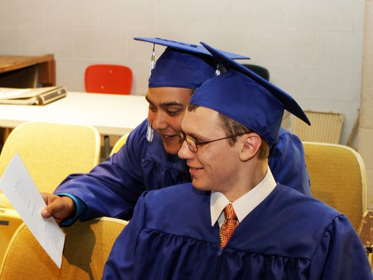 Stissing Mountain High School graduates Zachary Clum, left, and Noah Kischuk look over the 2014 program Saturday before commencement. In the fall, Noah will study computer information systems at Dutchess Community College and Zachary will study criminal justice at Columbia-Green Community College.