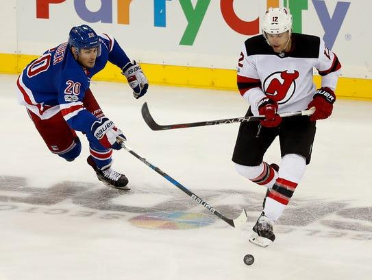 New York Rangers left wing Chris Kreider (20) and New