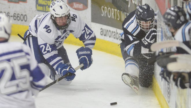 Notre Dame's Collin Appleton forces Bay Port's Skyler Kring into the boards as they battle for the puck. Bay Port defeated Notre Dame 3-2 at Cornerstone Community Ice Center in Ashwaubenon, Wis. on Saturday, Jan. 31, 2015.