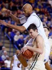 Delaware's Barnett Harris can't get to a rebound over
