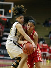 Piscataway's Tori Fisher (12) tries to get the ball away from Edison's Samira Sargent during the GMC Tournament final on Thursday, Feb. 22, 2018.