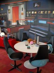 "Dave Arland's office in Carmel incorporates part of his extensive ""Star Trek"" memorabilia and recreates the USS Enterprise bridge from the original TV series."