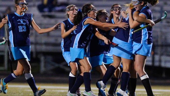 Dallastown celebrates after Maggie Noll scored the winning goal on a penalty shot during the YAIAA field hockey semifinal at York Suburban High School on Wednesday, Oct. 21.