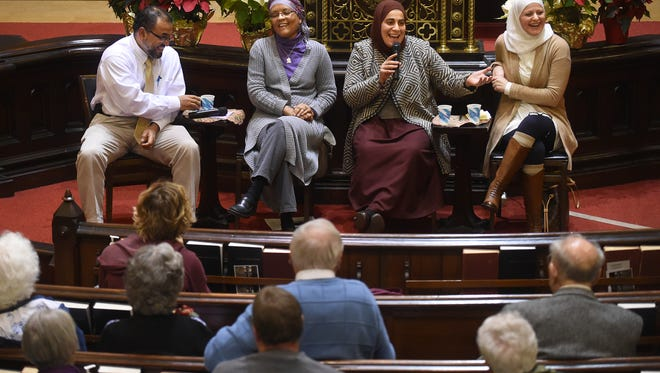 """ADVANCE FOR THE WEEKEND OF FEB. 7 - In this Jan. 28, 2015 photo, Reza Manor, from left, Linda Miller, Feral Salem and Maryam Bitar field questions from the audience at First Church-United Church of Christ in Middletown, Conn. The Middletown Refugee Resettlement Coalition organized the """"Honest Conversations with your Muslim Neighbors"""" forum. (Brad Horrigan/Hartford Courant via AP) MANDATORY CREDIT"""