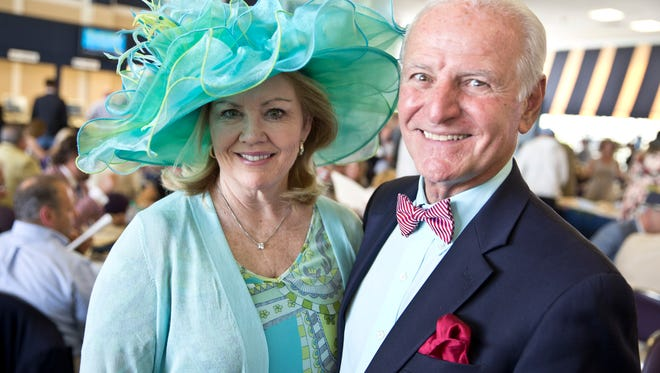 Jean Fitzsimmons of Brielle and Domenick Servodio, vice president New Jersey Market of TD Bank. The 13th annual Kentucky Derby celebration sponsored by the Asbury Park Press and Ray Catena Auto Group takes place at Monmouth Park. The Monmouth Park Charity Fund hosts the event that benefits local charities.Oceanport, NJ Saturday, May 7, 2016@DhoodHood