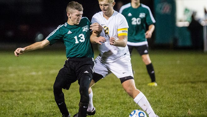 Delta's Isaac Griffis battles for possession against Yorktown's Dayne Patton during their game at the Yorktown Sports Park Saturday, Oct. 8, 2016. Delta defeated Yorktown 1-0 to win the sectional championship.
