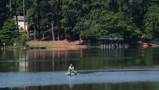 A man fishes from his boat on Lake Hartwell in Anderson on Wednesday. The first day of summer is June 21.