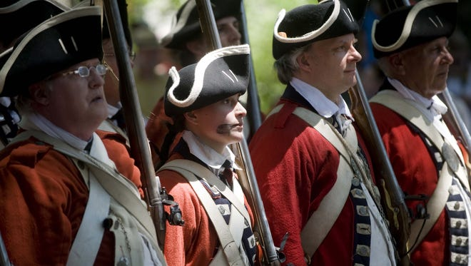 File: Members of the British troops march down Kings Highway in Haddonfield toward the Indian King Tavern Museum as they battle the New Jersey Volunteers during a re-enactment marking the 235th anniversary of the British encampment in Haddonfield. June 1, 2013.